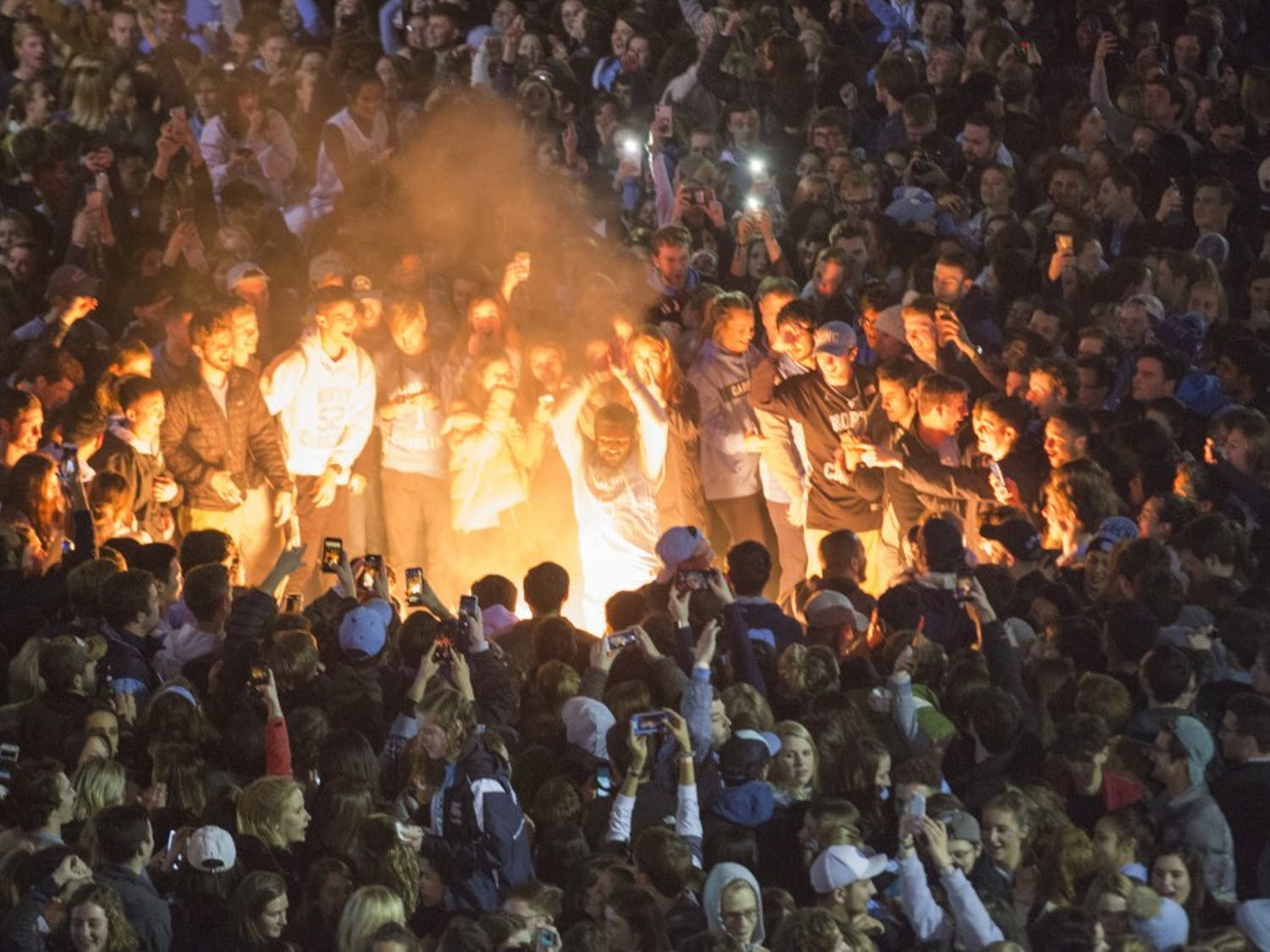 UNC students rush Franklin Street after No. 8 UNC defeated No. 1 Duke 88-72 at Cameron Indoor Stadium on Wednesday, Feb. 20, 2019.