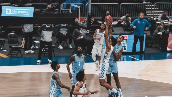 UNC sophomore forward Armando Bacot (5) attempts to block Kentucky sophomore forward Jacob Toppin (0) during a game on Saturday, Dec. 19, 2020. UNC beat Kentucky 75-63.