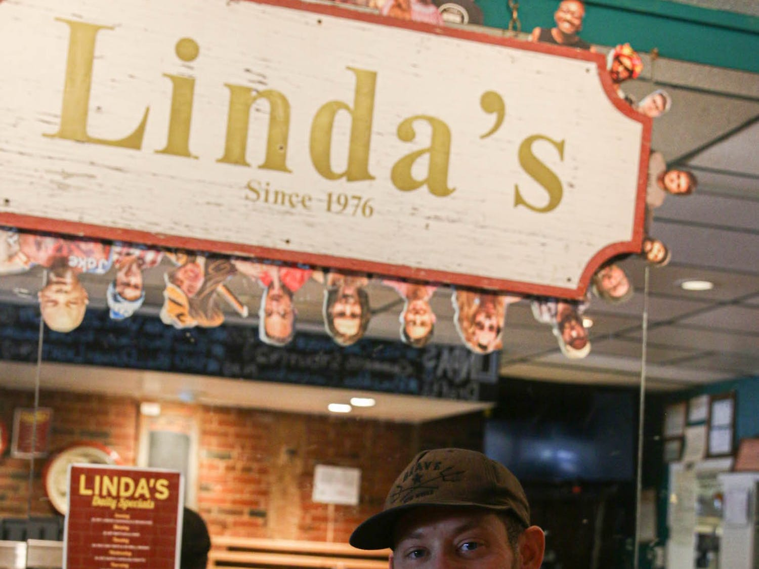 Linda's Bar and Grill owner, Christopher Carini, poses in front of his restaurant's sign on Tuesday, Sept. 29, 2020.