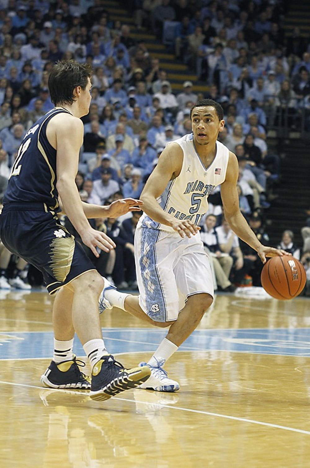Sophomore guard Marcus Paige (5) attacks the basket against a Notre Dame player. Carolina defeated Notre Dame 63-61 on Monday in the Dean Dome.