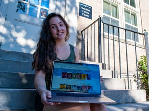 """Second year Global Studies and Political Science major Léa Ferre, a member of the Latinx community, poses for a portrait while browsing the new OverDrive collection at the Carolina Latinx Center on September 27. """"One thing that is exciting about the OverDrive collaboration is accessibility. I think that as UNC students, we often take for granted all that we have access to."""""""