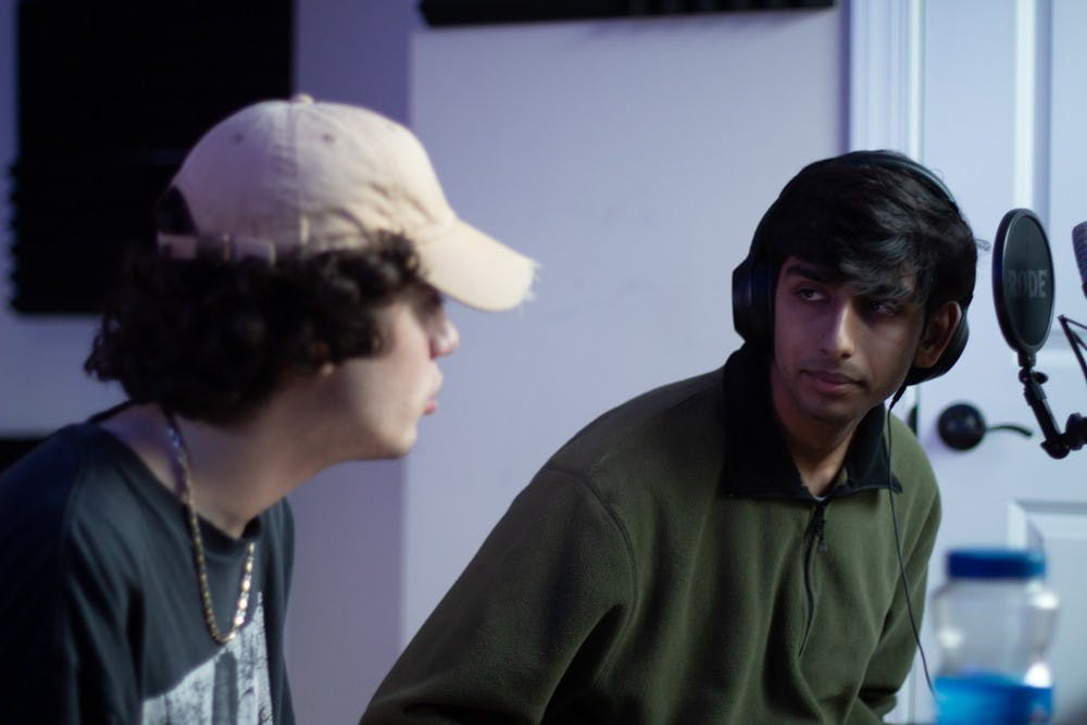 """<p>Marco Gomez and Tanmay Joshi, both 18-year-olds from Cary, discuss Weston Estate's soon-to-be-released song on Sunday, Feb. 2, 2020. The """"anti-pop"""" band draws from idols like Frank Ocean and Clairo.</p>"""