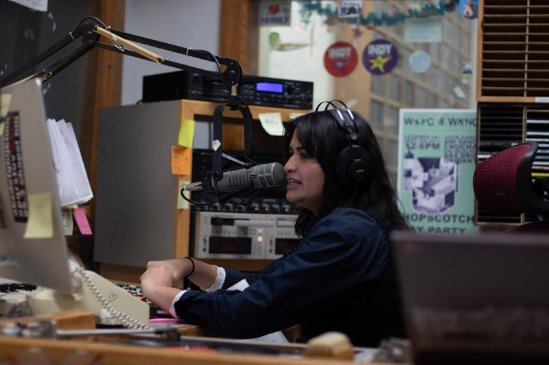 Ashley Choo-Hen, a senior classics and english major, provides commentary on the music being played during one of her DJ sets at WXYC. WXYC is celebrating the 25th anniversary of being the first radio station to live stream a program over the internet on Wednesday, Nov. 13, 2019.