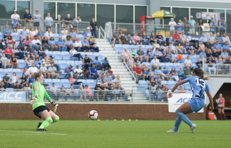 Freshman forward Isabel Cox (13) scores a goal to put the Heels up 2-0, securing the Tar Heel's ACC regular-season title win against Virginia Tech on Sunday, Oct. 27, 2019.