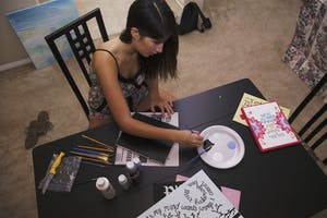 Christina Townsend, a junior communications and journalism major, creates works of art to sellto fellow students.