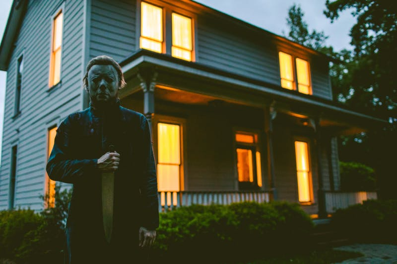 "A person dressed up as Michael Myers from the 1970s slasher film ""Halloween,"" standing in front of the Myers House N.C. owned by Kenny Caperton. Photo courtesy of the Carolyn Scott Photography and Fangoria Magazine."