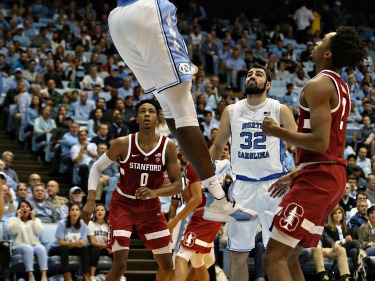 UNC forward Nassir Little (5) dunks against Stanford in the Dean Smith Center on Monday, Nov. 12, 2018. UNC won 90-72.