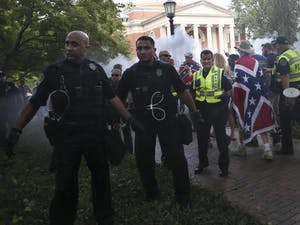Police from across North Carolina quickly escort demonstrators from McCorkle Place after their scheduled demonstration on Saturday, September 8th.