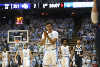 UNC guard Cameron Johnson celebrates after a play during the game against Gonzaga in the Dean Dome on Saturday night. UNC won 103 - 90.
