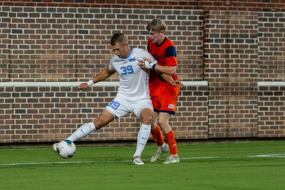 <p>UNC graduate forward Gerit Wintermeyer (39) keeps possession of the ball during the Tar Heels' match against the Bucknell Bisons on Thursday.&nbsp;</p>