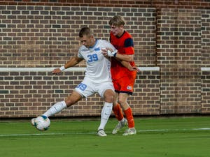 UNC graduate forward Gerit Wintermeyer (39) keeps possession of the ball during the Tar Heels' match against the Bucknell Bisons on Thursday.