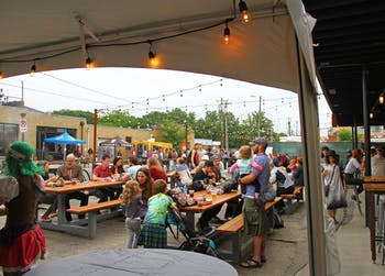 Crowds gather outside Motorco and Fullsteam in Durham to eat dinner before attending shows.