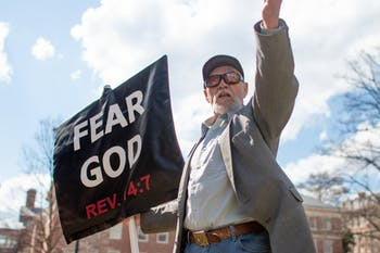 "Gary Birdsong, the ""Pit Preacher,"" holds up his sign as he preaches at Polk Place on Monday, March 18, 2019."
