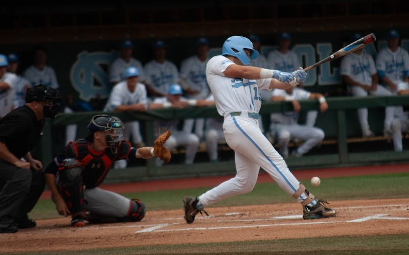 UNC baseball junior and 1B, Michael Busch (15), swings and misses the ball during the first game of the super regionals versus Auburn on Saturday June 8, 2019. Auburn beat UNC 11-7.