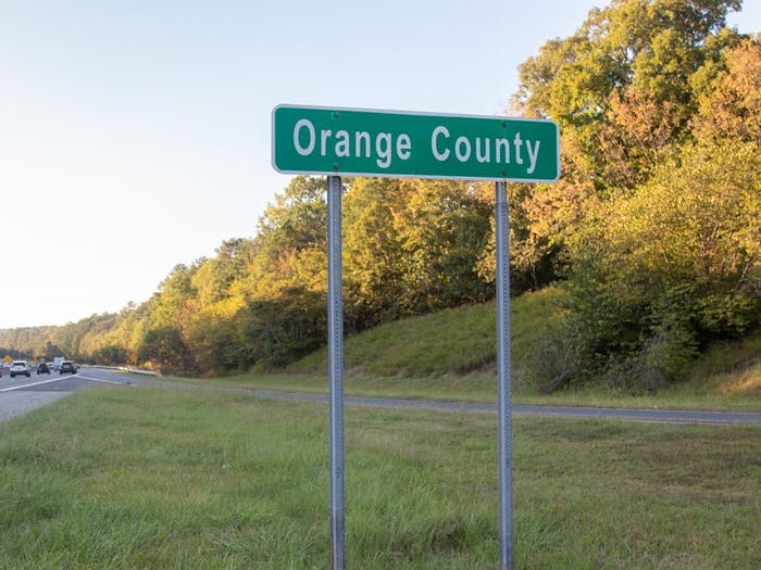 An Orange County sign is pictured on Interstate 40 on Oct. 13, 2021. On Oct. 8, Orange County launched a new Longtime Homeowner Assistance to provide property tax bill assistance to homeowners who have lived in Orange County for over 10 years.