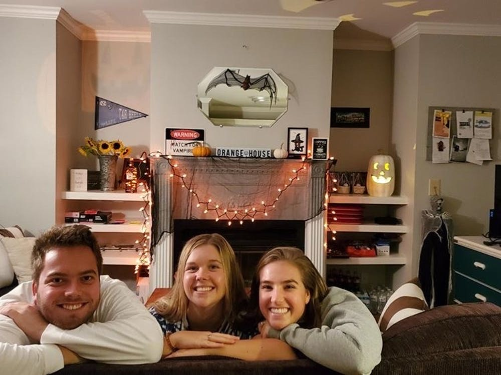(from left) Jacob Messer, Kayley Carpenter and Elizabeth Wheless in their living room filled with Halloween decorations as they prepare to celebrate the holiday. Photo courtesy of Elizabeth Wheless.