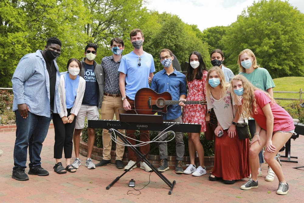 """<p>Participants of UNC Musical Empowerment's outdoor senior recital pictured last year in the Gene Stroud Community Rose Garden. Photo by <a href=""""https://www.dailytarheel.com/search?a=1&amp;s=Alex+Berenfeld+&amp;ti=&amp;ts_month=0&amp;ts_day=0&amp;ts_year=0&amp;te_month=0&amp;te_day=0&amp;te_year=0&amp;au=&amp;tg=&amp;ty=0"""" target=""""_self"""">Alex Berenfeld</a>.</p>"""
