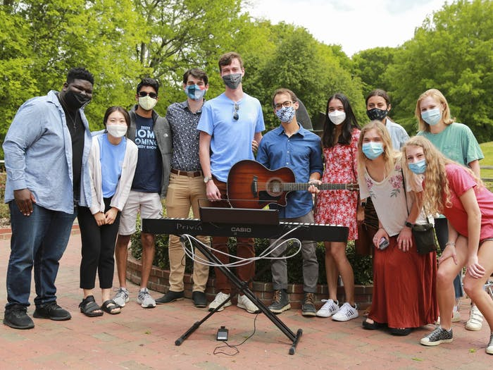 Participants of UNC Musical Empowerment's outdoor senior recital pictured last year in the Gene Stroud Community Rose Garden. Photo by Alex Berenfeld.