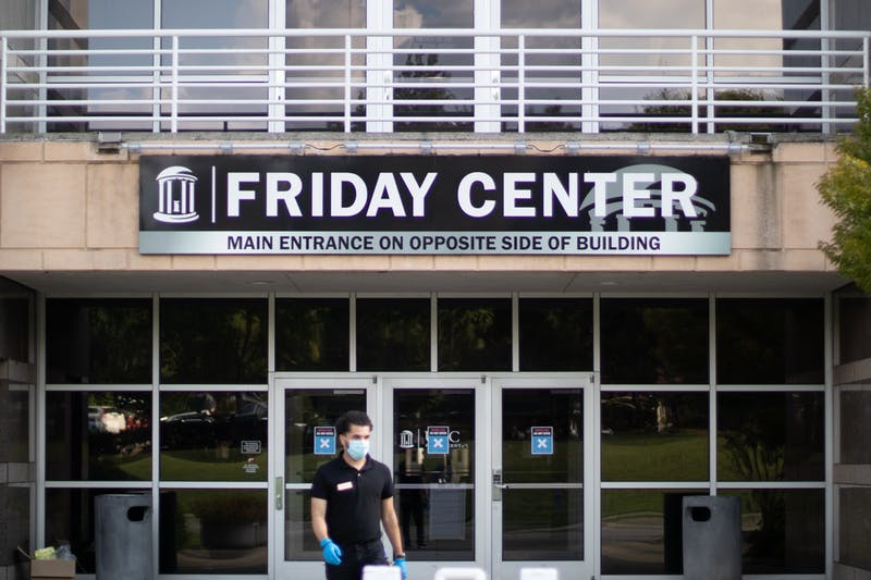 Alberto Rivera, set-up coordinator for the Friday Center exits the building on Tuesday, Aug. 11, 2020. Some classes have been moved to the Friday Center for the Fall 2020 semester to promote social distancing, but the change has created transportation problems for some students.