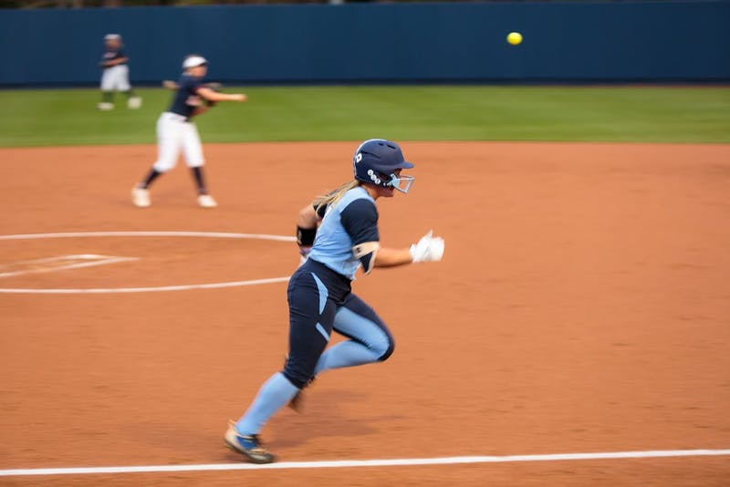 Shortstop Taylor Wike (#7) tries in vain to outrace the ball to first base.