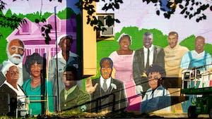 Located at 111 S. Merritt Mill Road, artist Kiara Sanders' new mural features 12 Black trailblazers.