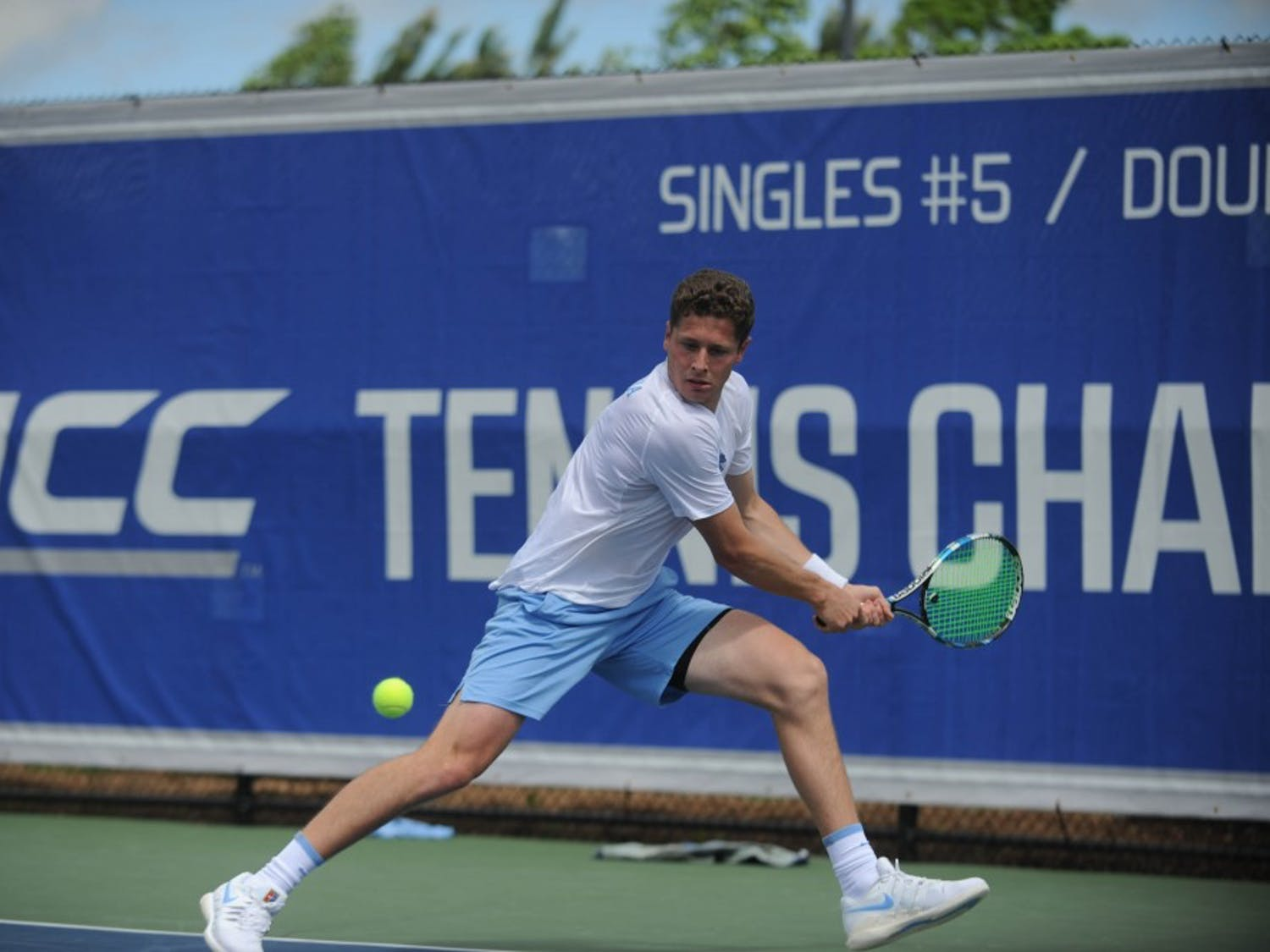 Senior Blaine Boyden backhands the tennis ball at the ACC tournament semifinals. UNC played against Virginia and lost 3-4. Boyden won his doubles match with junior William Blumberg and his singles match.