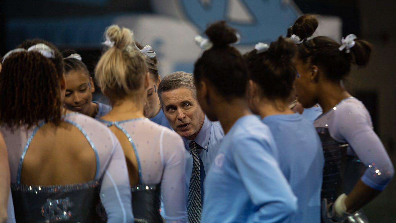 UNC Gymnastics Head Coach Derek Galvin speaks with the team after a meet against University of Pittsburgh on Saturday, Jan. 25, 2020 in Carmichael Arena.