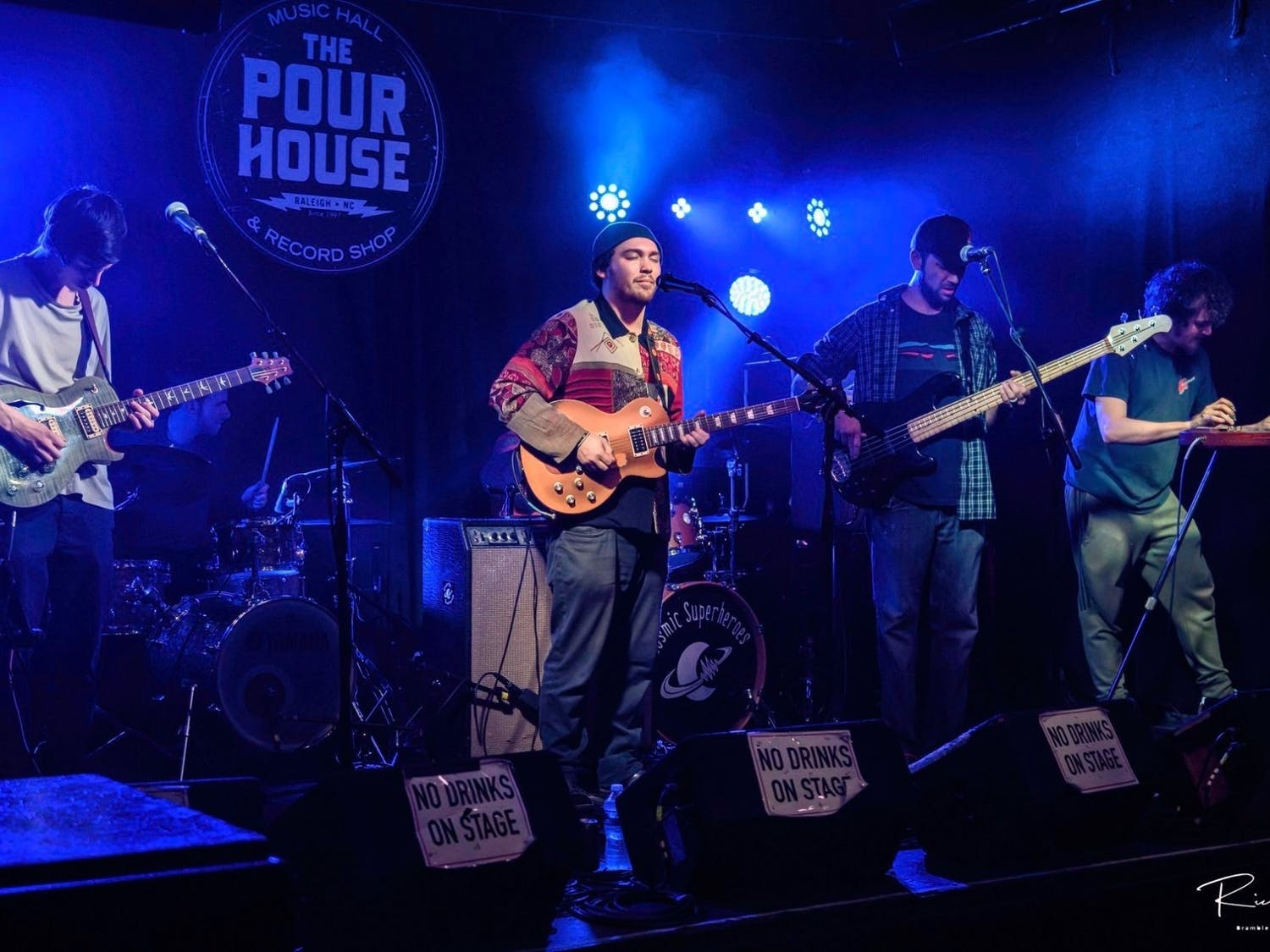 Photo of the Awen Family Band performing their music at The Pour House. Photo courtesy of Tim Husk.