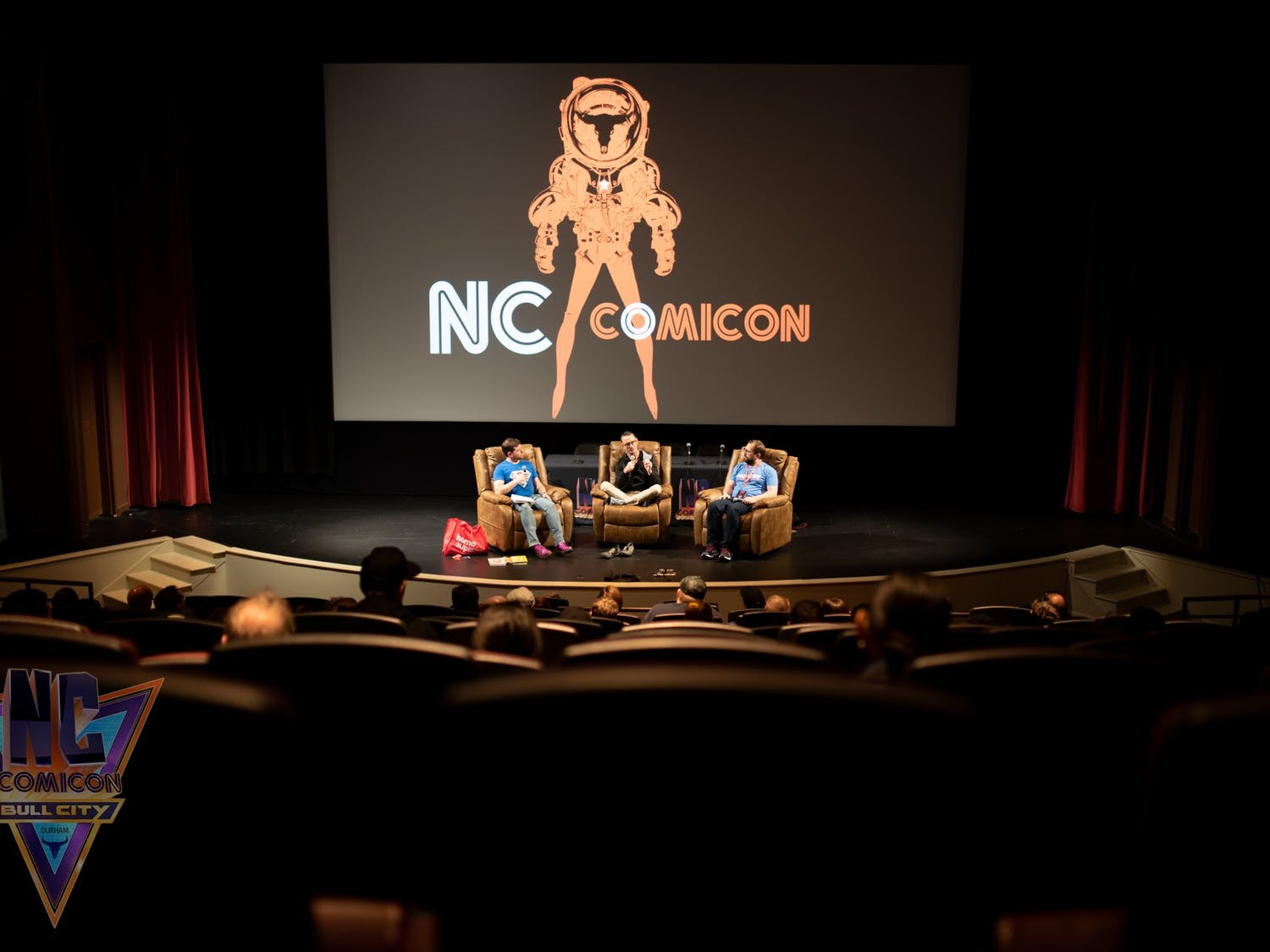 """NC ComiconPanel DirectorMatt Conner M.D. (far left) and Ssalefish Comics owner Bret Parks (far right) interview legendary """"Fight Club"""" author Chuck Palahniuk (center) about how his books transition intofilms.Photo courtesy of NC Comicon lead photographerCordelia Danan."""
