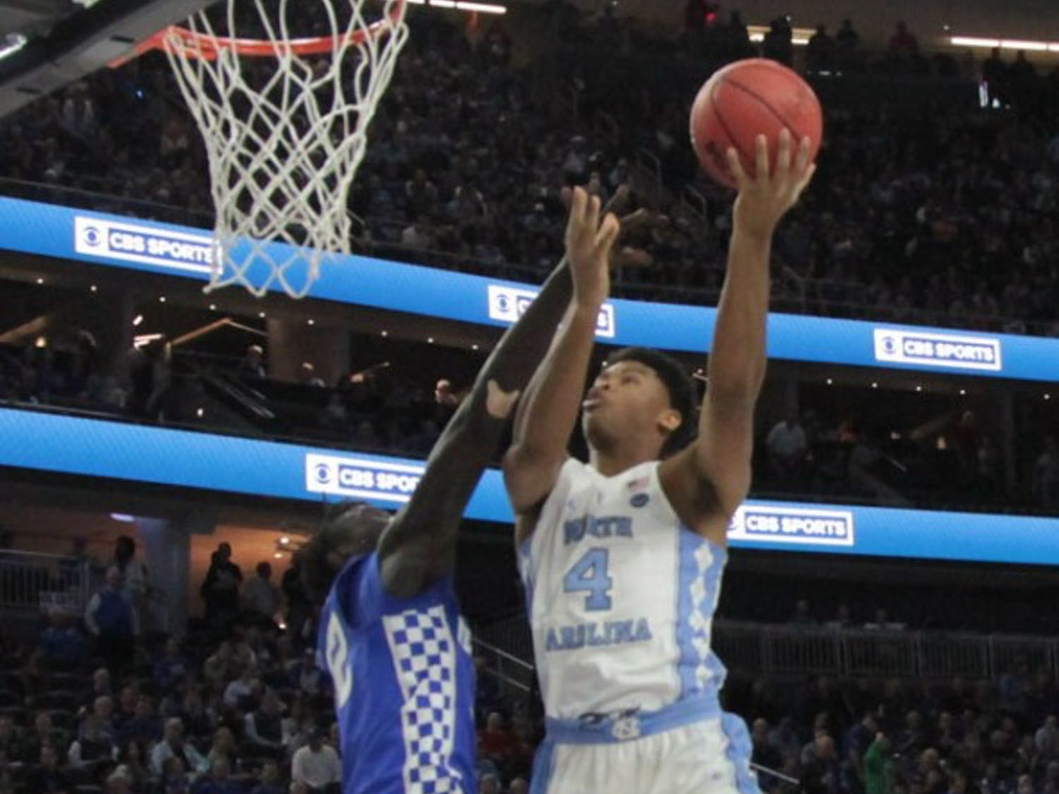 UNC forward Isaiah Hicks (4) goes up for a contested layup against Kentucky at the CBS Sports Classic on Saturday.