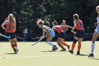 Senior midfielder Eva van't Hoog (22) of the UNC field hockey team weaves through a swarm of Syracuse players in a 5-1 win on Saturday, Sept. 29, at Karen Shelton Stadium in Chapel Hill, N.C.