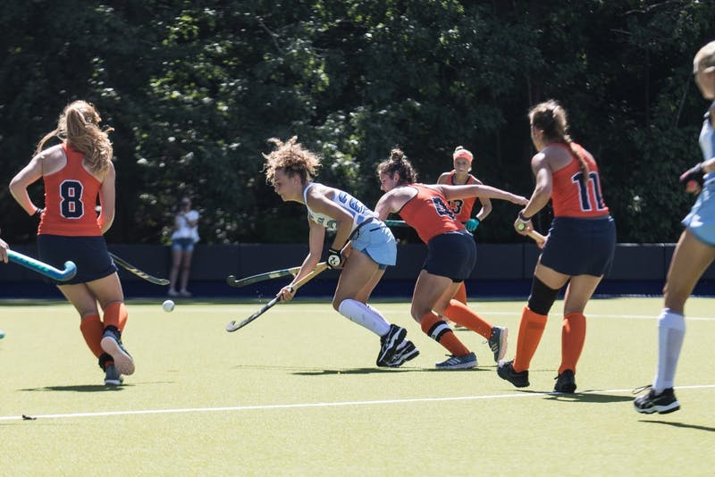 Senior midfielder Eva van't Hoog (22) of the UNC field hockey team weaves through a swarm of Syracuse players in a 5-1 win on Saturday, Sept. 29, at Karen Shelton Stadium in Chapel Hill, N.C.
