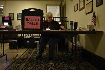 Connie Wilkins runs the ballot box table at The Chapel of the Cross church at 304 E. Franklin St. on Oct. 23, 2018. The Chapel of the Cross severs as an early voter location close to the University of North Carolina at Chapel Hill's campus.