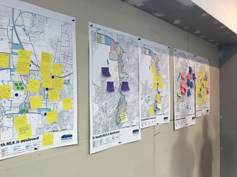 Community-drawn maps are hung up at the first show-and-tell for updating the Future Land Use Map of Chapel Hill