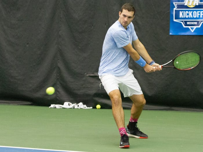 Senior William Blumberg prepares to return the ball to Vazha Shubladze of Georgia State in the Cone-Kenfield Tennis Center on Sunday, Jan. 26, 2020. The Tar Heels won 4-0.