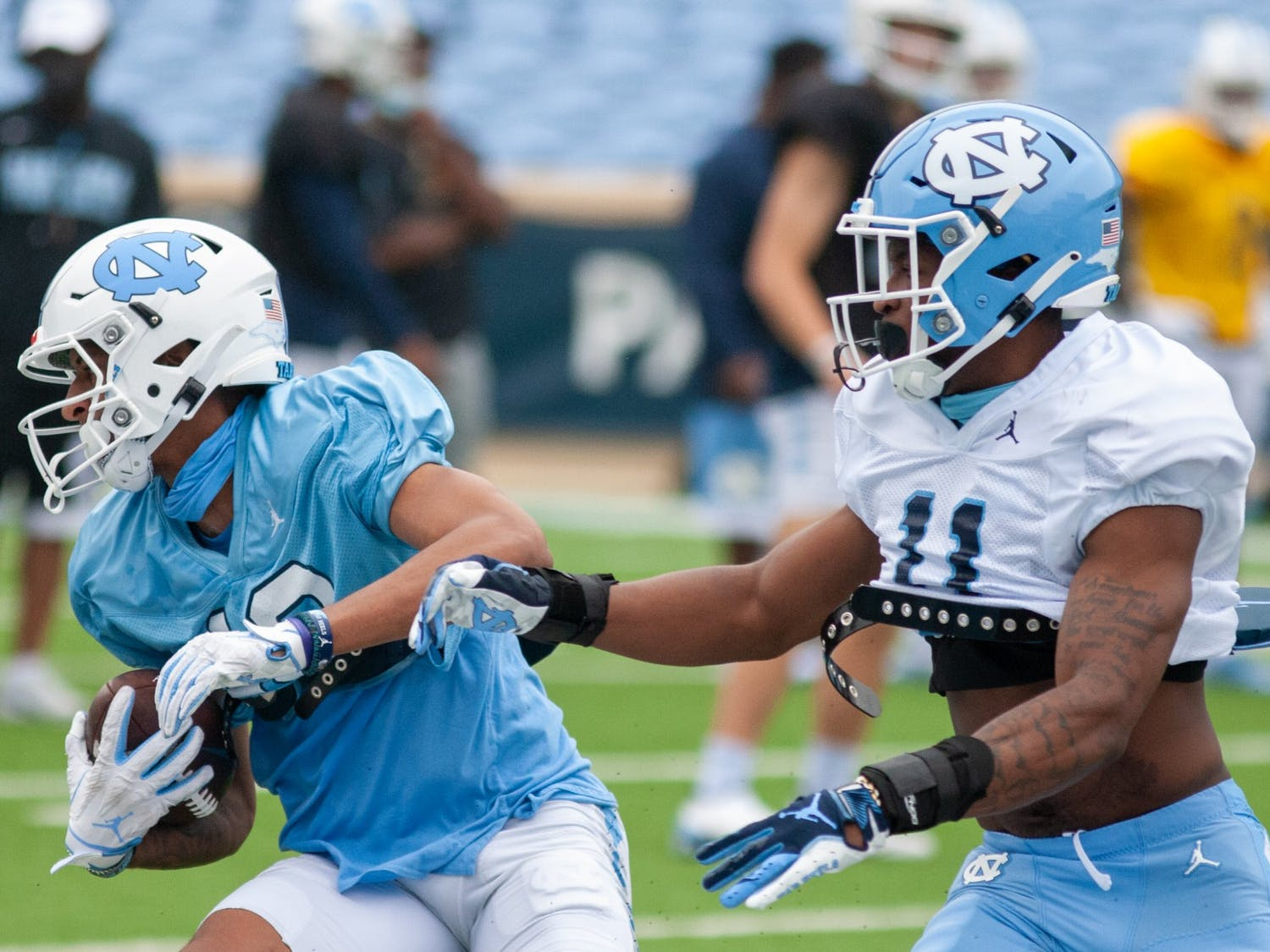 """After the departure of several star players for the NFL draft following the 2020 season, UNC football looks to rebuild and strengthen its younger starters. """"We're real fired up out there,"""" sophomore wide receiver Josh Downs said. """"The energy is crazy. I've never been part of a team with this much energy. If you go out there and you're slow, you're going to get embarrassed. Everybody is giving a hundred."""""""