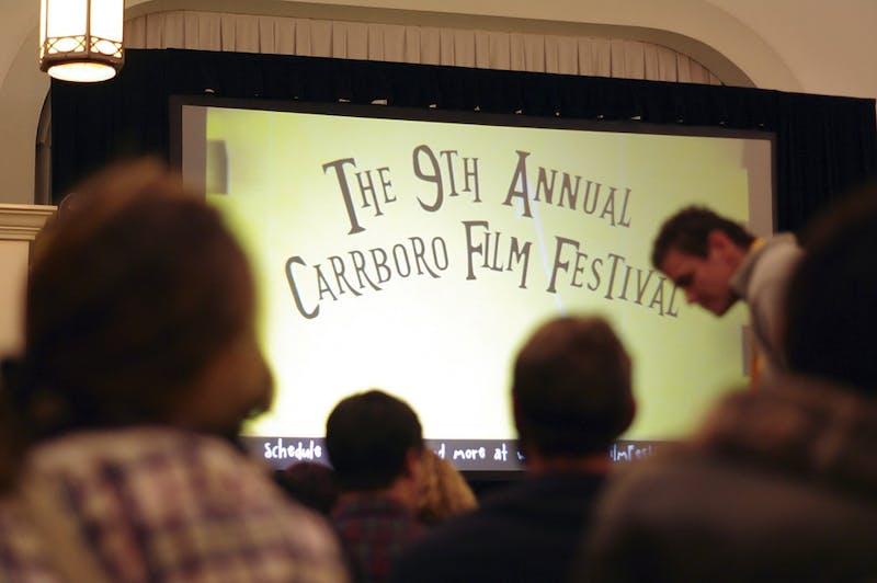 Attendees of the 9th annual Carrboro Film Festival prepare to watch a series of short films by UNC alumnus Jon Kasbe at the Carrbor Century Center on Saturday November 22.
