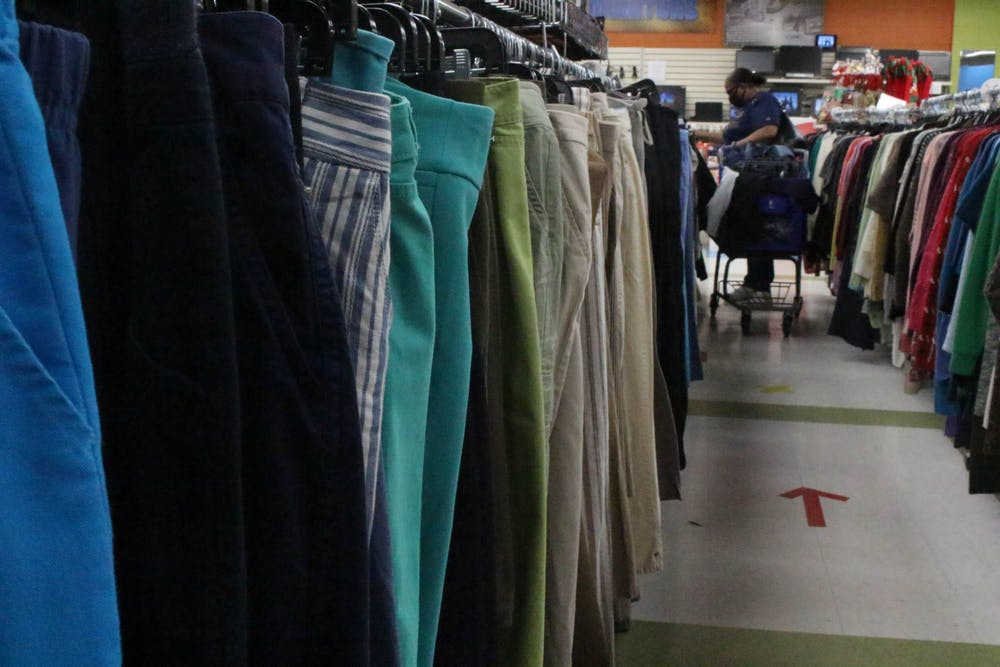<p>A customer shops at a Goodwill thrift store in Greensboro, N.C. on Thursday, Nov. 5, 2020</p>