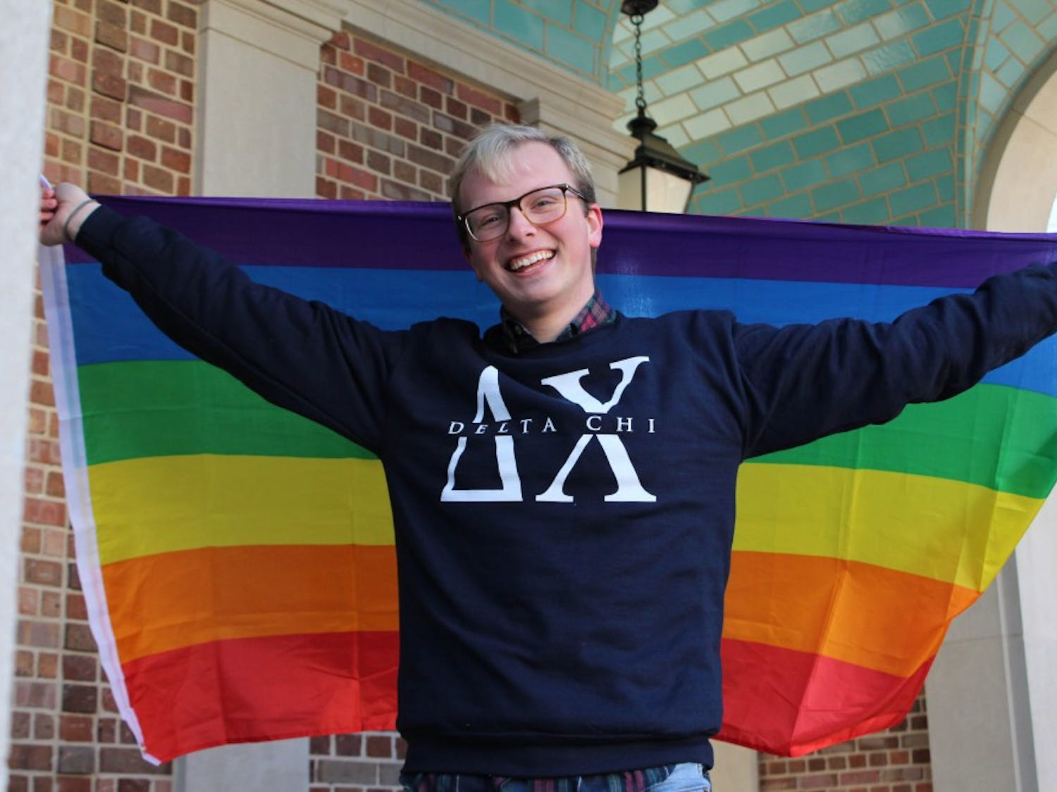 """Sophomore Ryker Smith, chemistry major, in front of the Morehead-Patterson Bell Tower on Thursday, Jan. 31, 2019. Smith is one of the founding fathers of the Delta Chi fraternity at UNC and a member of the LGBTQ community. Smith says that in his experiences with Greek life he has not experienced homophobia and that """"he loves all of his brothers and all of his brothers love him."""""""