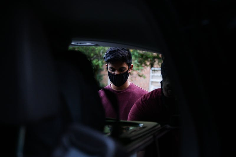 Sophomore Sahil Hira loads items into his car outside Ehringhaus Residence Hall on Tuesday, Aug. 18, 2020.