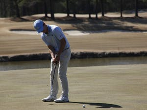 First-year Dougie Ergood making a putt during UNC's win at the second day of the Tar Heel Intercollegiate hosted at Finley Golf Course on Sunday, March 24, 2019.