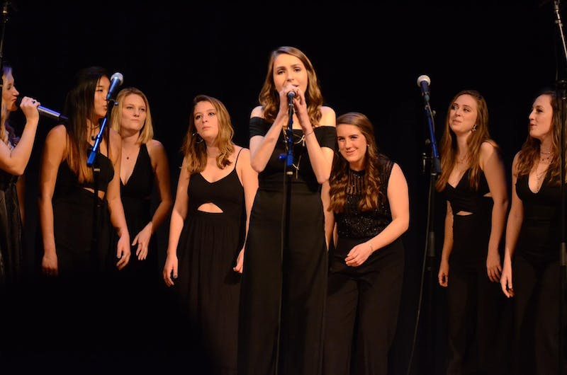 """UNC senior and Loreleis President Julia Kelly performs at a UNC Loreleis concert. UNC's premier all-female a capella group, the Loreleis, will release a new album titled """"Solstice"""" on April 18. Photo courtesy of Amy Smith."""