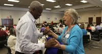 Shirley Massey, Chaplain at the Burn Center, and Larry Stanford, retired Raleigh fire chief and volunteer at the burn center for 20 years, dance along to the Dakata Street Band at the reunion banquet for survivors on Saturday.