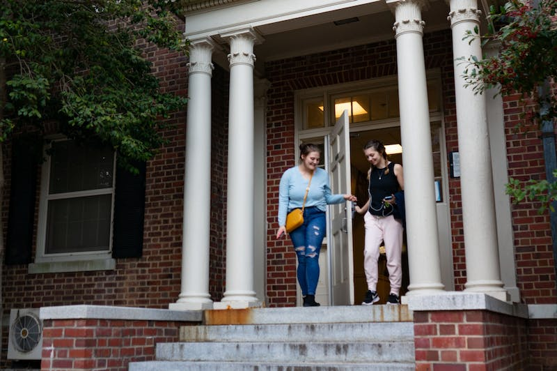 Sophomores Deanna Gibson (left) and Sarah Brown (right) exit Spencer Residence Hall on Sunday, Mar. 1, 2020. Built in 1924, Spencer was the first all-female residence hall, but is now co-ed.