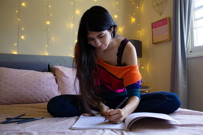 """Alexandra Smith, a senior media and journalism and Hispanic linguistics double major is photographed in her apartment on Saturday, Nov. 9, 2019. """"I just wish people at UNC realized [mental health is] something that shouldn't be stigmatized,"""" Smith said. """"It's something that should be normal and prioritized just as much as your physical health is."""""""
