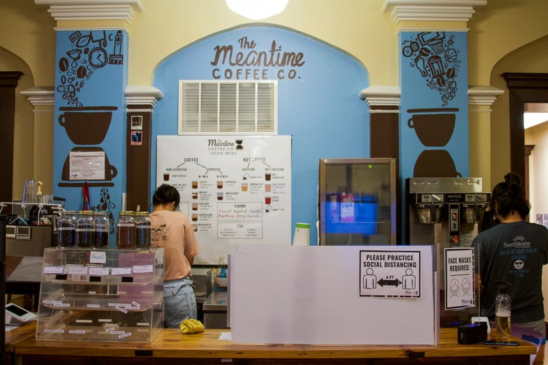 Two employees prepare drinks inside The Meantime Coffee Co. for no-contact pickups on Tuesday, Sept. 8, 2020.