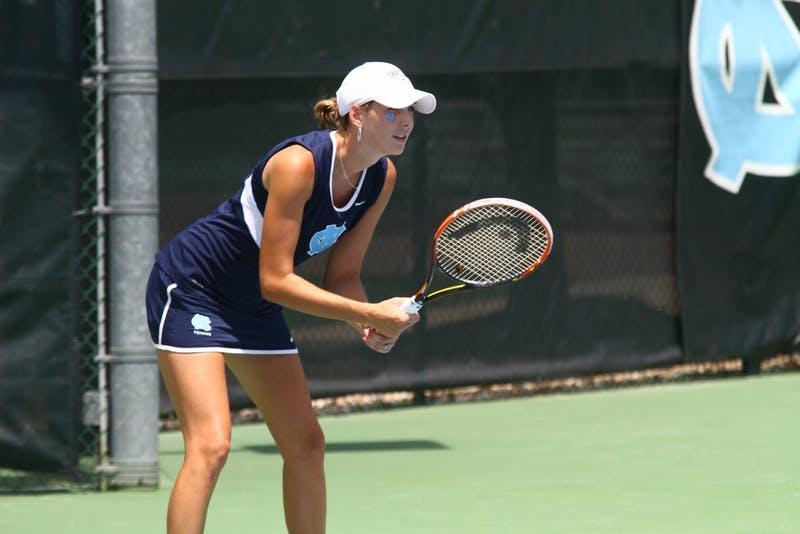 Caroline Price awaits a serve from her singles opponent.