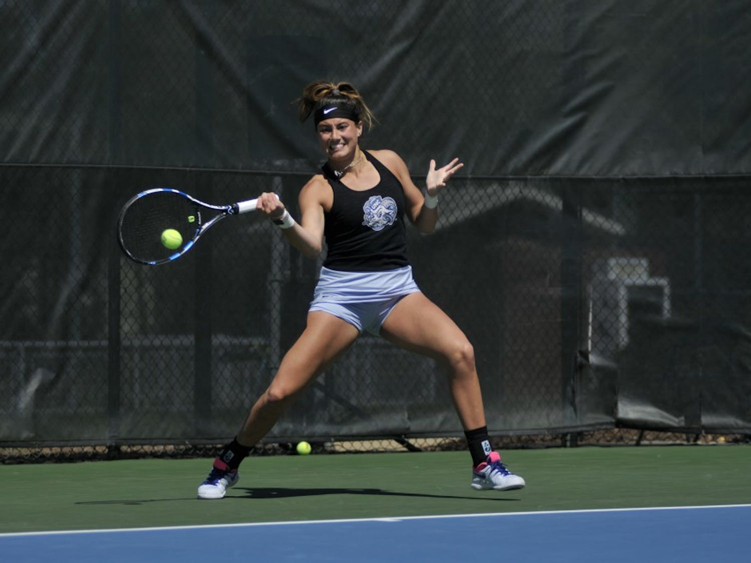 Junior Alexa Graham prepares to hit the ball while playing for the UNC women's tennis match against Miami on Sunday, March 24, 2019 at the Cone-Kenfield Tennis Center. UNC won 4-3. Graham scored the winning point for UNC.