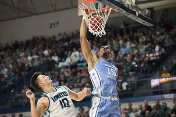 UNC junior forward Garrison Brooks (15) sinks a basket during their game against UNC-Wilmington in Trask Coliseum on Friday, Nov. 8, 2019.