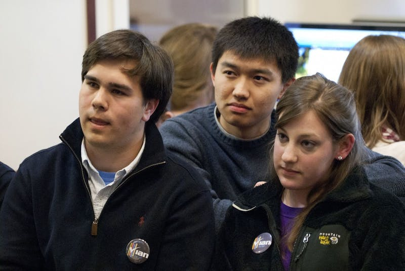 Ian Lee reacts with campaign managers Andrew Lu and Olivia Hammill as the election results are announced. Lee lost to Mary Cooper, who won with 62 percent of the vote.